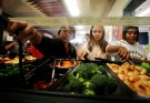 Students get their lunch from a salad bar at the school cafeteria as some of more than 8,000lbs of locally grown broccoli from a partnership between Farm to School and Healthy School Meals is served at Marston Middle School in San Diego